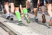 Detail of the legs of runners at the start of a marathon race  — Stock Photo