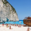 Zakynthos, Greece - June 01: Tourists at the Navagio Beach in Zakynthos, Greece on June 01, 2014. Navagio Beach is most popular attraction among tourists visiting the island of Zakynthos. — Stock Photo #50739237