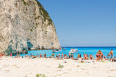Zakynthos, Greece - June 01: Tourists at the Navagio Beach in Zakynthos, Greece on June 01, 2014. Navagio Beach is most popular attraction among tourists visiting the island of Zakynthos.  — 图库照片