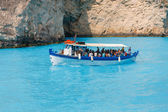 Zakynthos, Greece - June 01: Tourists at the Navagio Beach in Zakynthos, Greece on June 01, 2014. Navagio Beach is most popular attraction among tourists visiting the island of Zakynthos.  — Foto de Stock