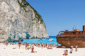 Zakynthos, Greece - June 01: Tourists at the Navagio Beach in Zakynthos, Greece on June 01, 2014. Navagio Beach is most popular attraction among tourists visiting the island of Zakynthos.  — ストック写真