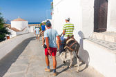 LINDOS, GREECE - JUNE 24: Unidentified tourists walking in historic town Lindos on June 24, 2008. Lindos is most popular turist destination located in the Rhodes Island, eastern Aegean Sea. — Stock Photo