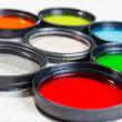 Color filters for lenses on bright background — Stock Photo #51506833