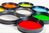Color filters for lenses on bright background — Стоковое фото
