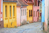 Medieval street view in Sighisoara founded by saxon colonists in XIII century, Romania — Stok fotoğraf