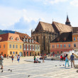 BRASOV, ROMANIA - JULY 15: Council Square on July 15, 2014 in Brasov, Romania. Brasov is known for its Old Town, which is a major tourist attraction includes the Black Church, Council Square and medie — Stock Photo #51632099