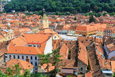 BRASOV, ROMANIA - JULY 15: Council Square on July 15, 2014 in Brasov, Romania. Aerial view of Old Town in Brasov, major tourist attraction — Stock Photo
