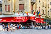 TIMISOARA, ROMANIA - JULY 22, 2014: McDonalds restaurant at Pia?a Victoriei, Timisoara, Romania. Mc Donalds is the world biggest fast food chain.  — Stock Photo