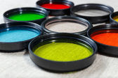 Color filters for lenses on bright background — 图库照片