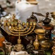 Old fashioned menorah and other antique decorative items on the  — Stock Photo