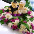 Element on wedding car (flowers and toy) — Stock Photo