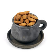 Cup of almonds isolated on white. — Stock Photo