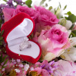 Stock Photo: Betrothal detail of rings and bouquet
