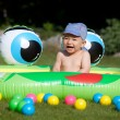 Baby boy and kids rubber pool — Stock Photo