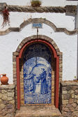 Small altar made ??of Azulejos in the Alte - famous village in the Algarve, Portugal — Stock Photo