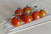 Cherry tomatoes on the branch — Stock Photo