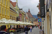 BRASOV, ROMANIA - JUNE 18, 2014: Tourists visit old town of Brasov on JUNE 18. The town is the 7th most populous city in Romania, The city is known as a birthplace of the national anthem of Romania. — Stock Photo