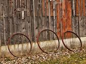 Three wagon wheel rims — Stock Photo