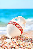Beautiful vase on the seashore against blue sky — Stock Photo