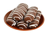 Chocolate biscuits on the brown plate — Stock Photo
