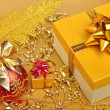 Stock Photo: Golden gift boxes, christmas bauble, plume, garland