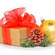 Gift box with red mesh bow, christmas baubles and cone — Stock Photo