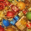 Bright christmas baubles, toys, garland, gift boxes — Stock Photo #16194197