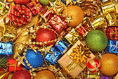 Bright christmas baubles, toys, garland, gift boxes — Stock Photo