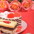 Valentine cakes, tarts and red roses on the red tablecloth — Stock Photo