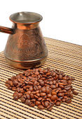 Сoffee pot and coffee on the tablecloth — Stock Photo