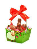 Easter chocolate bunny and eggs in the gift basket — Stock Photo