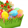 Easter colored cloth eggs, roses in the flowerbed isolated on th — Stock Photo