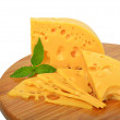 Cheese and mint on the wooden board  — Stock Photo