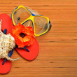 Stock Photo: Mask, seashell, flower and flip flop sandals on wood