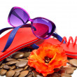 Flip flops, sunglasses, flower and pebble stones — Stock Photo