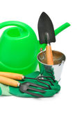 Watering-can, rake, pot, rubber gloves — Stock Photo