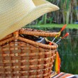 Cowboy hat, fishing tackle, towels and  wicker basket in the nat — Stock Photo