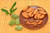 Almonds on the saucer — Stock Photo