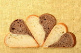 Slices of heart shaped bread — Stock Photo