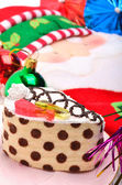 Christmas cake, christmas baubles and Santa Claus oven glove — Stock Photo