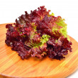Fresh red lettuce on the wooden board — Stock Photo