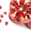 Stock Photo: Ripe pomegranate fruit isolated on white