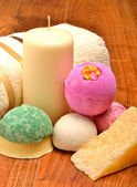 Candle, soap, bath bombs and bath towel on the wooden background — Foto Stock