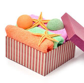 Colorful stacked spa towels, bath bombs and starfishes in the gi — Stock Photo