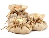 Rice, barley and buckwheat in cloth sacks — Stock Photo