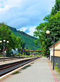 Railway track at the railway station. Cloudy weather and sun — Stock Photo