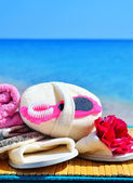 Natural bath sponges, bath slippers, pumice and towel against bl — Stock Photo