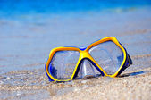 Yellow blue mask in blue water  — Stock Photo