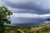 Rainfall over Lake Toba. — Stock Photo