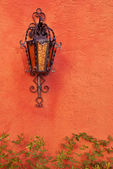 Old lamp on terracotta wall — Stock Photo